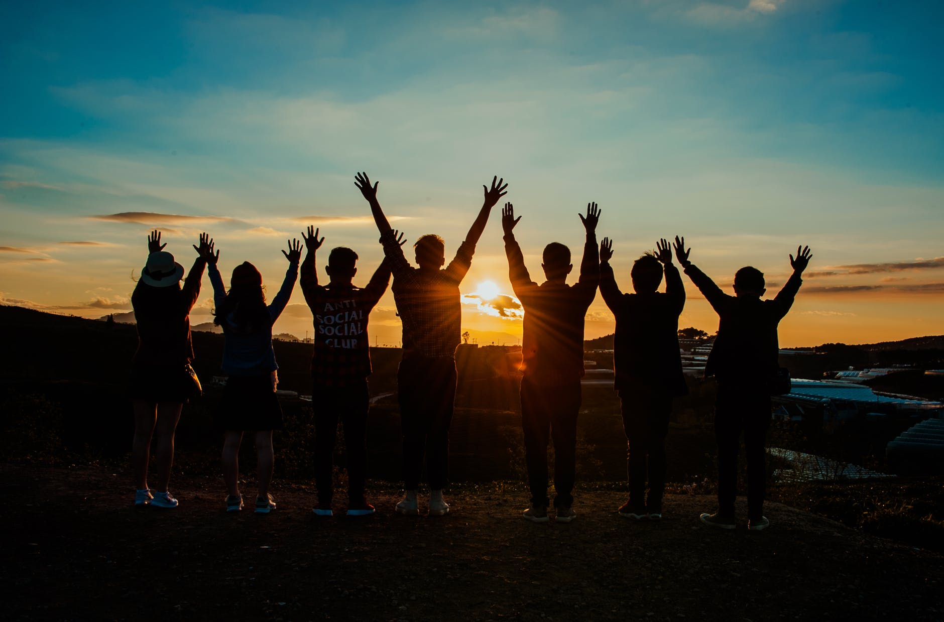 Silhouette of group picture with a sunset